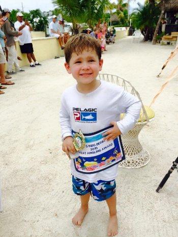 Kid at tournament in Islamorada, Florida Keys with a fishing charter